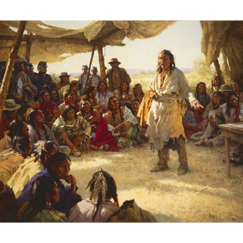 Native American Man Standing in Middle of Crowd, Gesturing towards a table