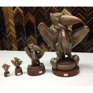 Four Bronze Jayhawk Statues, Each Increasing in Size
