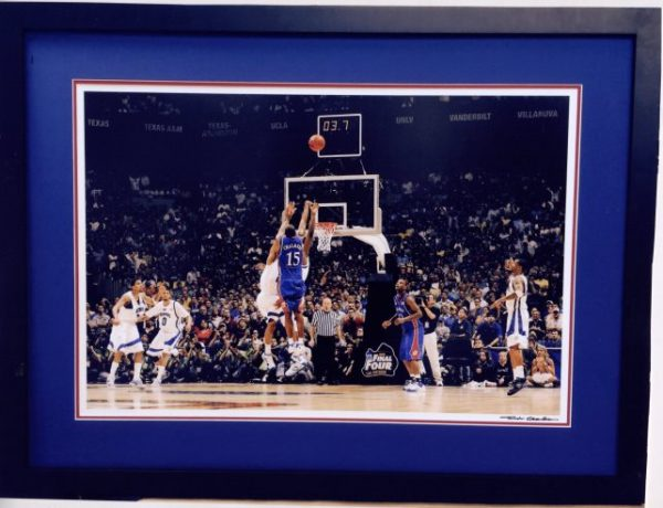 Framed Picture of Mario Chalmers taking a jumpshot while being defended with 3.7 seconds left on the clock, black frame with blue background