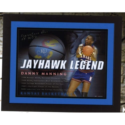 Hand Signed Danny Manning Photo, holding bastkeball with Jayhawk Legend and career highlights printed, as well as KU basketball in background