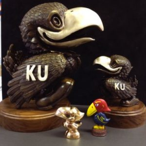 "Four Jayhawk Figures 10"" Tall and 2"" Base - Two Jays with KU and Walnut Base, Two Smaller Jayhawks one Multicolored"
