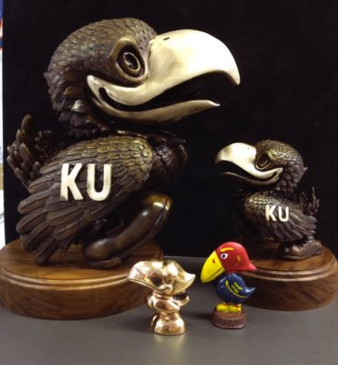 "Four Jayhawk Figures 6"" Tall and 2"" Base - Two Jays with KU and Walnut Base, Two Smaller Jayhawks one Multicolored"