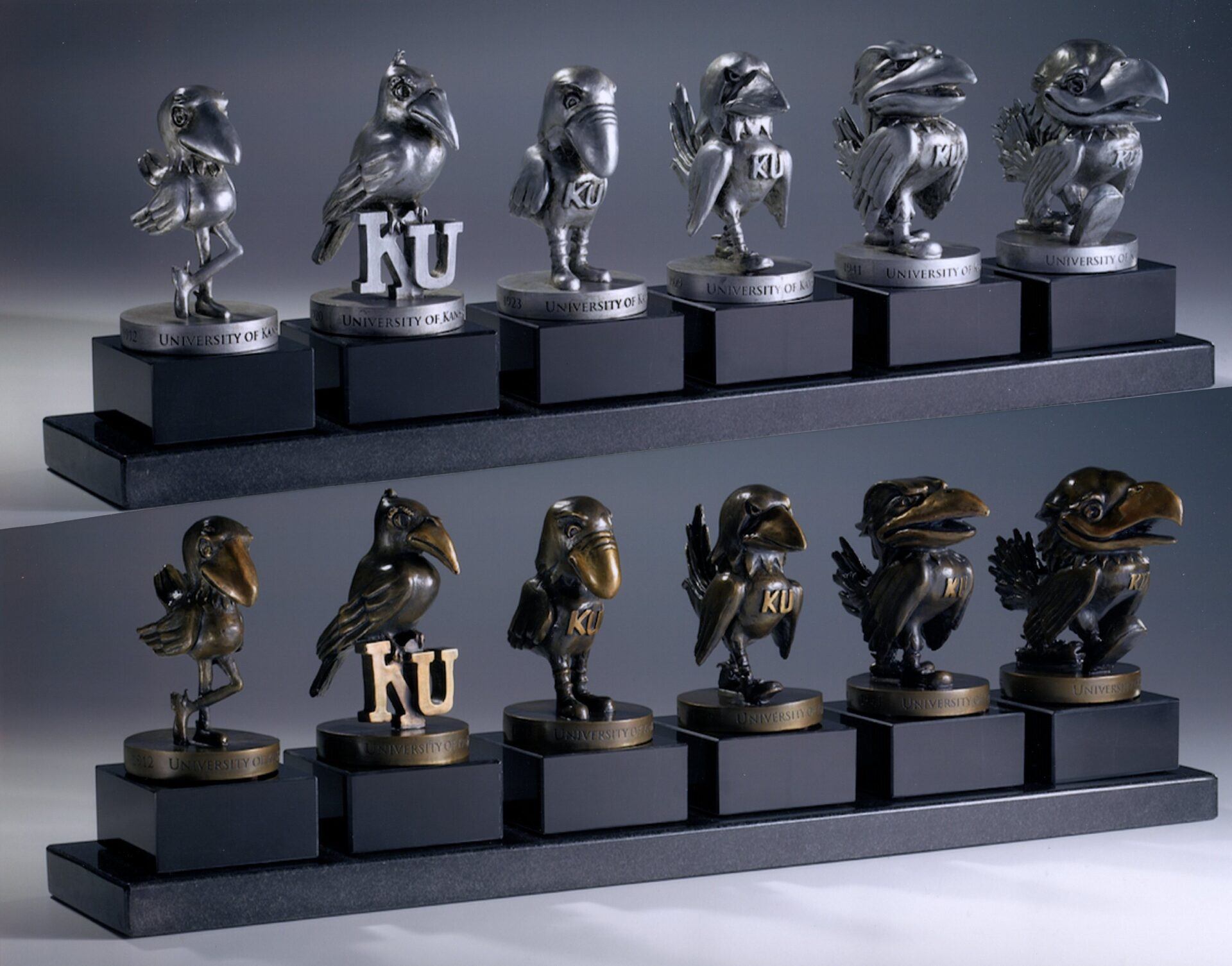 6 Pewter & 6 Bronze with Black Base - Evolution of the Jayhawk Figures