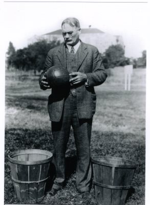 Black and White Photo James Naismith with Ball and Baskets