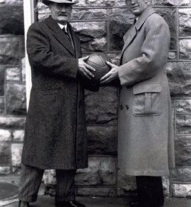 Black and White Photo James Naismith & Phog Allen Holding Basketball Together